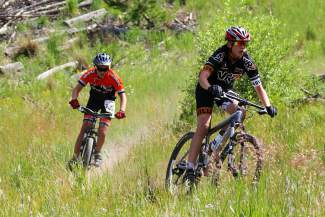 Two riders whip through the singletrack during the 15K mountain bike leg of the Frisco Triathlon in 2015. Before the race returns this July, local trainers give tips on how to build full-body strength for mountain biking.
