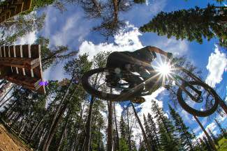 A competitor in the Big Mountain Enduro airs off the Fuzzy Karl drop on the TNT trail at Keystone. The Keystone Bike Park, home to the Enduro on July 9-10, opened to the public on June 10 with all 56 trails and more than 2,360 feet of vertical drop.