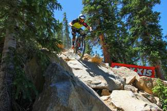 A competitor picks through the Jag Rock boulder line on the second day of the Big Mountain Enduro race, held last summer at Keystone. The Keystone Bike Park opens to the public on June 10.