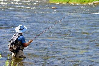 Mark Weitzman, of California, tries out fly-fishing for the first time in the Eagle River earlier this summer.  Less crowds and cooler temperatures will mean great fall fishing the next couple weeks.