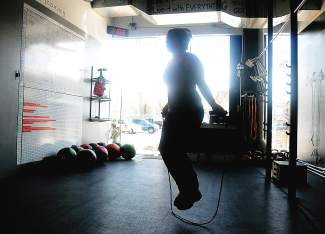 Christy Buster jumps rope as part of her CrossFit training session at CrossFit Venture in Avon. Aspects of CrossFit are heavily competition-based, with a leaderboard at every local gym and even a CrossFit Games with both regional and worldwide competitions.