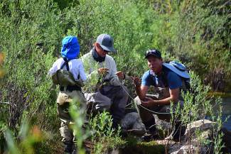 Andy Jackson, a guide at Vail Valley Anglers, helps prepare the fly-fishing rod for Brady Weitzman, while his dad, Mark, watches. Columnist Mark Palz found serenity and spirituality in the ritual of fly-fishing — but only after taking the time to appreciate how it fit into the hectic rituals of life.