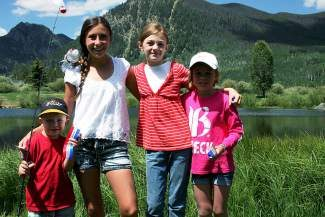 The 2014 winners of the Frisco Fourth of July fishing derby are, from left, Mack Lukasiewicz, of Dillon, Abby Pulley, Emma Ackerman, of Brighton, Colorado, and Haylee Haas of Sanger, Texas. The young anglers all caught 12-and-a-half inch trout to win.