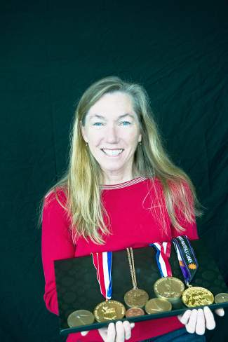 Longtime Summit County local Peggy Bailey with medals from a storied rowing career some four decades long. In April, Bailey and her team from the 1976 Olympics were honored at the National Rowing Foundation's Hall of Fame induction in Florida.