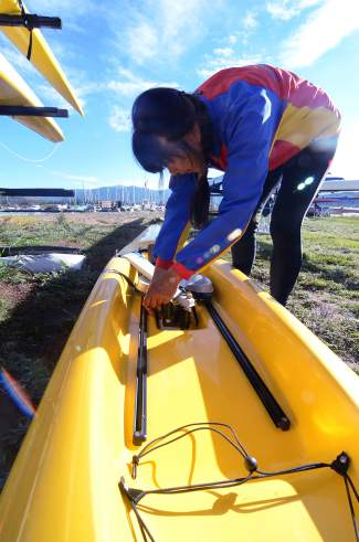 Frisco Rowing Center director Joanne Stolen preps a boat before teaching an introductory rowing session at Lake Dillon in August. Stolen has been rowing since college, when she apprenticed under a coach at Rutgers University.