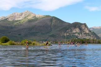 Competitors in the 2014 Frisco Triathlon on July 18 paddle furiously during the SUP round, a 3K cruise on Lake Dillon.