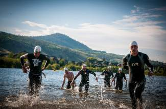 Competitors slosh from North Pond to the Ute Pass bike leg at the 2014 Rocky Mountain Triathlon. The event returns this year with sprint, Olympic and relay categories on Aug. 7.