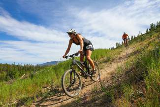A rider braces for a descent during the 15K mountain bike leg of the Frisco Triathlon, held July 18 at the Frisco Peninsula.