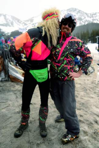 Ward Malek, left, kisses Keith Van Iderstine, both 33, of Breckenridge, at Arapahoe Basin Ski Area on Wednesday, April 1, 2015. Malek said his 1980s outfit came from a friend of his parents, and the trim happened to exactly match Van Iderstine's jacket, which was worn by Van Iderstine's sister in the early 1990s.