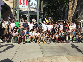 A crew of more than 50 skateboarders lines up in front of Lumberyard Snow and Skate shop in Breck for a cruise down Main Street to the Breck skate park for Go Skateboarding Day on June 21.