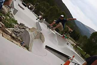 Z Griff takes indy over a boulder hip at the Breckenridge Skate Park for Go Skateboarding Day on June 21.