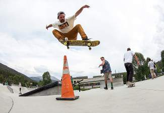 Breck's Kelly Fox lays a nasty ollie over the cone for Go Skateboarding Day at the Breck skate park on June 21.