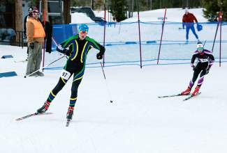 Two high school Nordic skiers round a corner during the Gold Run Rush races in Frisco on Jan. 9.