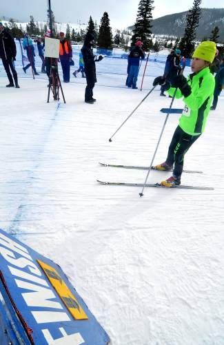 A Summit Nordic Ski Club middle school athlete crosses the finish line at the Gold Run Rush in Frisco on Jan. 9.