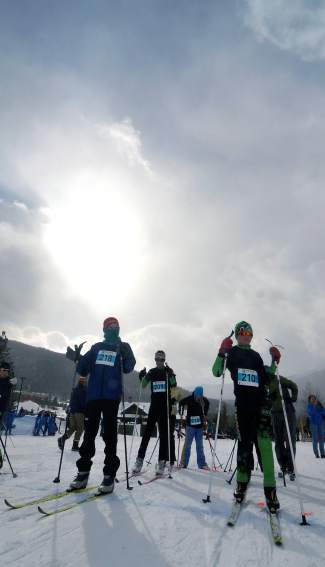 Young Nordic skiers stay warm at the start line before the 3K fun race at Gold Run Rush on Jan. 9 in Frisco.