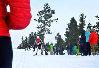 A middle school athlete with the Aspen Valley Ski and Snowboard Club passes by parents and other cheering spectators in the final stretch of the Gold Run Rush Nordic races in Frisco on Jan. 9.
