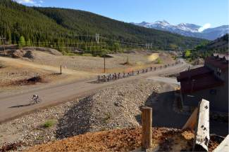 The first wave of mountain bikers takes off from the start line for the Gold Run Rush on June 15. More than 150 junior and adult mountain bikers came to French Gulch for the annual tour of B&B, Minnie Mine and other routes past dredge ponds and mine tails east of downtown Breckenridge.