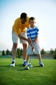 Helping your junior golf hit better off the tee can be as simple as teeing up the ball higher and having the young golfer approach the ball with a more forward stance. This tip can also serve fullsize golfers.