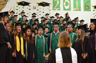 Summit Singers performed the national anthem at the beginning of Saturday's graduation ceremony.