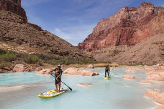 Eagle County locals Javier Placer, left, and Scotty Stoughton, enjoy a mellow section of the Colorado River during their 280-mile standup paddleboard journey through the Grand Canyon this spring.