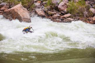 Part-time Eagle County resident and Standup Paddle Colorado co-owner Javier Placer takes navigates a rapid on his standup paddleboard in the Grand Canyon.