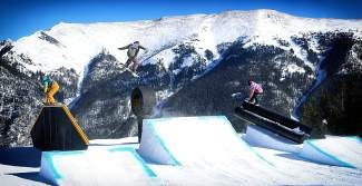 Snowboarders hit features in the Central Park terrain park at Copper Mountain. This week the worlds best skiers and riders are in Copper Mountain for the Sprint U.S. Grand Prix, a U.S. Olympic team qualifying event.