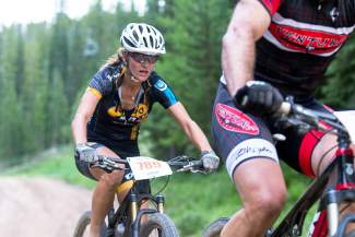 Gretchen Reeves drafts behind another biker while grinding up the second climbing section of the Vail Grind mountain bike race in 2015. Reeves joins several other local pros for the Pedal Power high-altitude youth bike camp in Leadville from June 12-15.