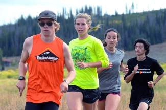Senior McKenna Ramsay (second from front) trains with teammates on the Tigers cross-country team before the fourth meet of the season, the Eagle Valley Invite at Gypsum Creek Golf Course on Sept. 19.