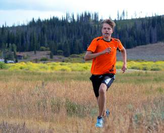 Senior captain Alex Mason powers through drills during cross-country practice near Summit High School before the team's fourth meet of the season, the Eagle Valley Invite at Gypsum Creek Golf Course on Sept. 19.