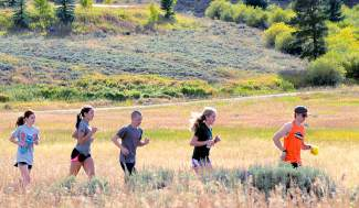 The Tigers cross-country team in their natural element, shot on Instagram by @SumCoSports with hashtag #SumCoSports