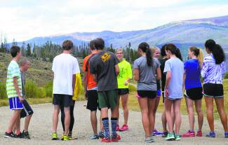 The Tigers cross-country team warms up before practice outside of Summit High School. The team's next meet is the Eagle Valley Invite on Sept. 19 at Gypsum Creek Golf Course.