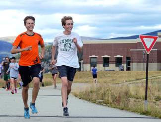 Summit seniors Alex Mason (left) and Alex Lehman lead a warm-up run during Tigers cross-country practice near Summit High School before the fourth meet of the season, the Eagle Valley Invite at Gypsum Creek Golf Course on Sept. 19.