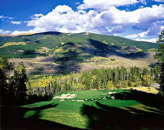 Hole 8 at the Raven Golf Club at Three Peaks outside of Silverthorne. The Par 3 drops 120 feet over 184 yards from the back tees. The club's Front 9 is currently open, with the Back 9 scheduled to open in the next 1-2 weeks.
