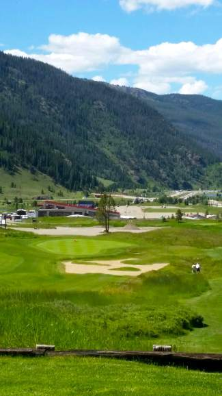 The view of Copper Creek's Hole 14 from the highest tee box in North America, located 9,863 feet above sea level and more than 100 feet above the green. The course is scheduled to open on June 10 with a full 18 holes.