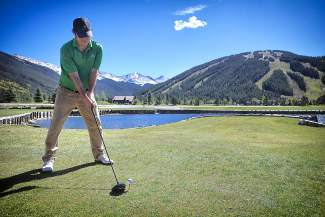 A golfer tees up at Copper Creek golf course at Copper Mountain Resort. The course is scheduled to open on June 10 with a full 18 holes.