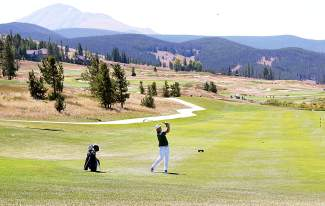 Summit High School's Keegan Cancelosi takes a shot from the fairway during the Keystone Ranch Invitational, hosted on The Ranch Course, one of two full courses at the 36-hole club. The River Course opens May 13, followed by The Ranch Course on May 27.