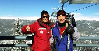 Werner Haas (right) with National Ski Patrol Volunteer Sandra DeGarie at Keystone. The two met and DeGarie was impressed to hear the 87-year-old Austrian native and university professor still skis upwards of 35 days per season.