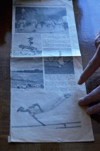 Werner Haas points to a photo of himself on the parallel bars during the World Gymnastics Championships in the late 1930s. The image was printed in a Viennese newspaper with the caption: