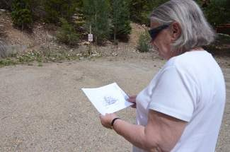 Nancy Shockey, executive director of Summit Habitat for Humanity, examines plan drawings for the local chapter's next home construction project in the Woodmoor development in Breckenridge. On Wednesday the local organization will host a blessing and ceremonial ground breaking.