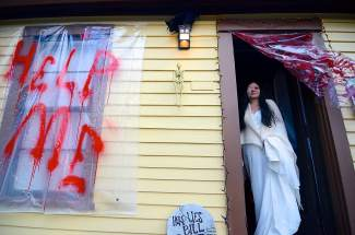 Tracy Dollars, aka Sylvia the Haunted Widow, darkens the doorstep of the Breckenridge Heritage Alliance's haunted house on Harris Street on Friday, October 31.
