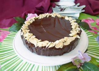 Chocolate … dark and rich, enhanced by a hint of almond and a melt-in-your-mouth texture, this chocolate almond flourless torte can make any meal seem special.