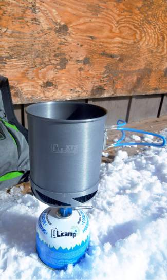 The complete Olicamp Kinetic Ultra stove kit, with stove, four-season fuel and pot.
