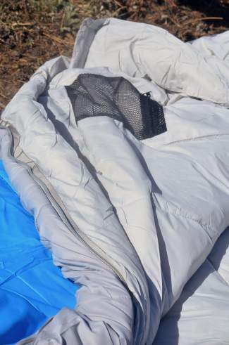 Detail on the inside of the Peregrine Saker zero-degree sleeping bag. Along with a roomy mummy cut, the bag also features a hood baffle, zipper baffle, interior mesh pocket and shaped foot box.