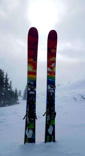 The 2015-16 Liberty Origin men's skis, with 116 mm underfoot and alpine touring bindings.