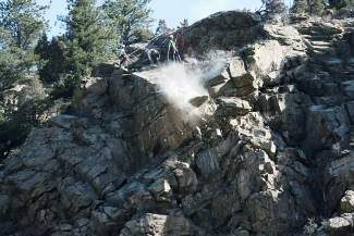 Work crews perform rock scaling operations Thursday, April 10 on Interstate 70 at the Twin Tunnels near Idaho Springs. Because boulders can bounce onto the highway, CDOT officials are periodically holding traffic for 30 minutes so workers can safely remove the rocks.