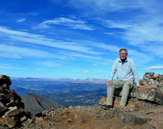 The author rests at the summit of Quandary Peak.