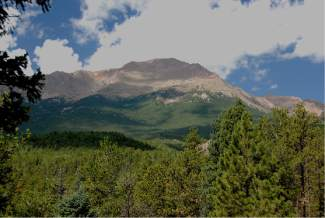 Pikes Peak touches the clouds south of Woodland Park.