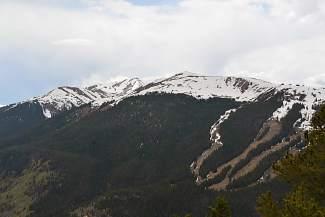 The half-melted slopes and alpine fields of Resolution Bowl at Copper Mountain from the Wheeler Trail near Breckenridge.