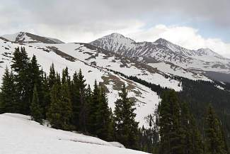 The view of Peak 10 (center) and Quandary Peak from halfway along the Wheeler Trail in June, when snowdrifts can still be as tall as a man.