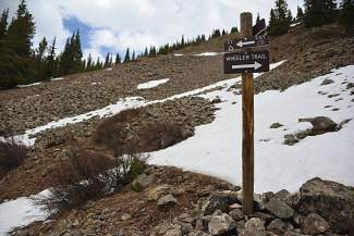 The start of the Wheel Trail in mid-June, with portions still covered in snow.